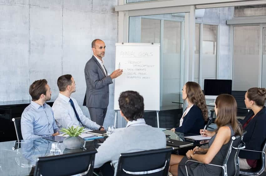 A manager giving a presentation to his large team