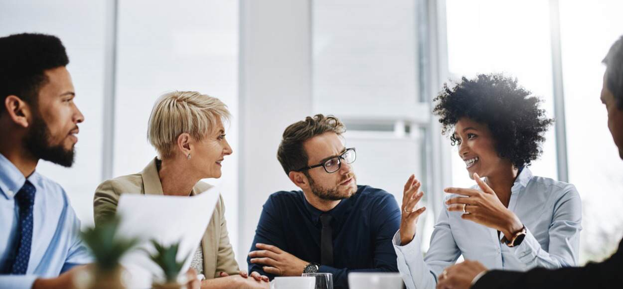 Group of adults sharing ideas in office