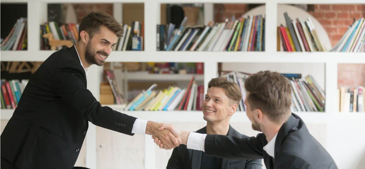 Businessman greeting colleagues
