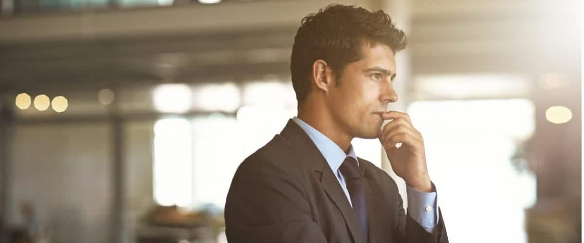 Man is pondering something in office