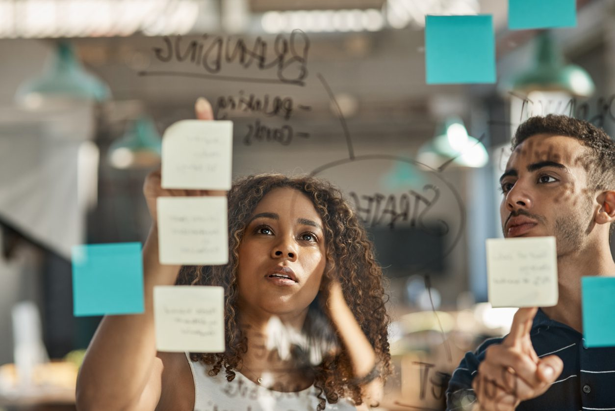 colleagues looking at post-it notes