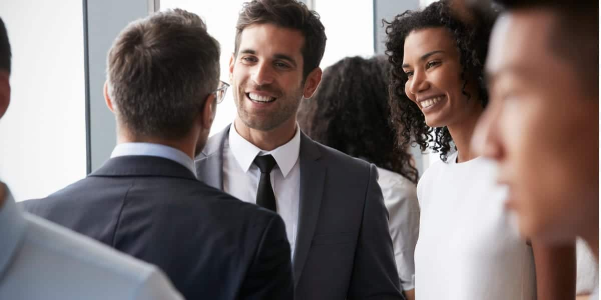 Business people smiling and networking