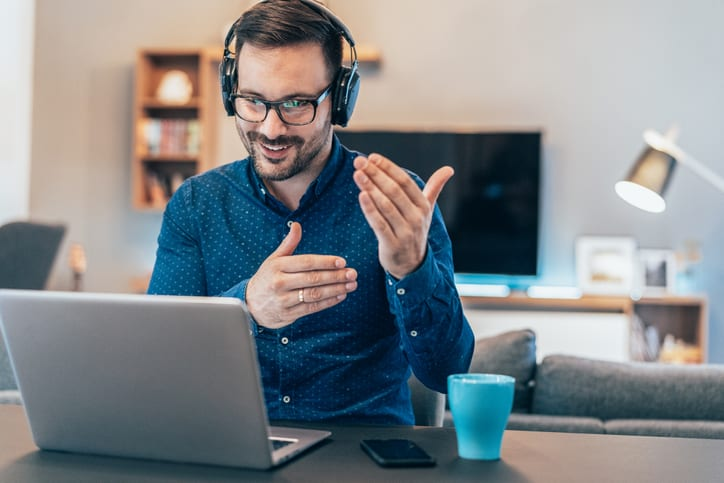 man talking on conference call over laptop