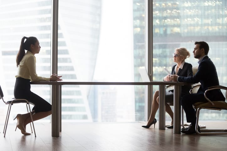 Asian applicant introducing talking to hr managers at job interview in modern office, recruiters interviewing listening to vacancy candidate recruiting sitting at table, hiring and employment concept