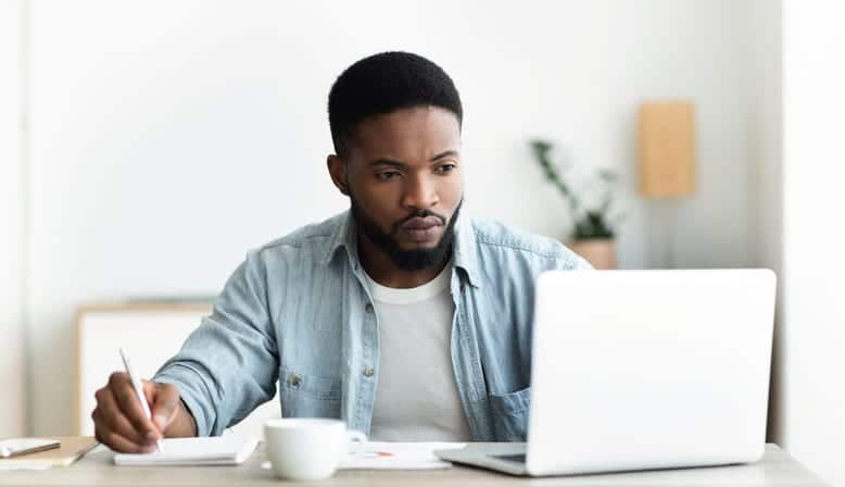 man searching for jobs online