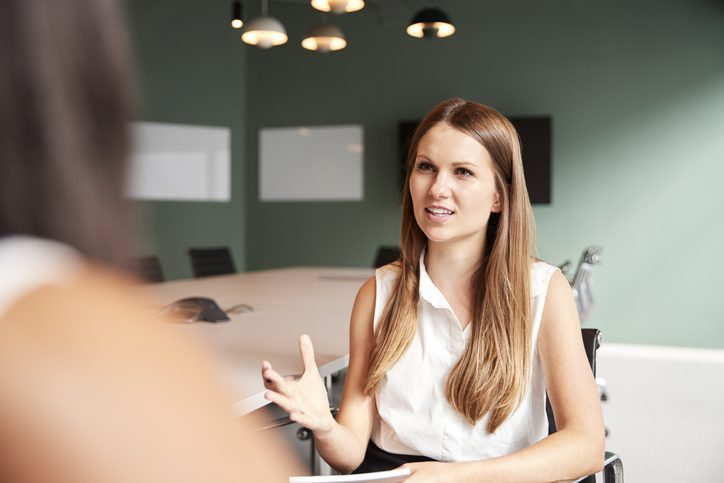 businesswoman conducting interview